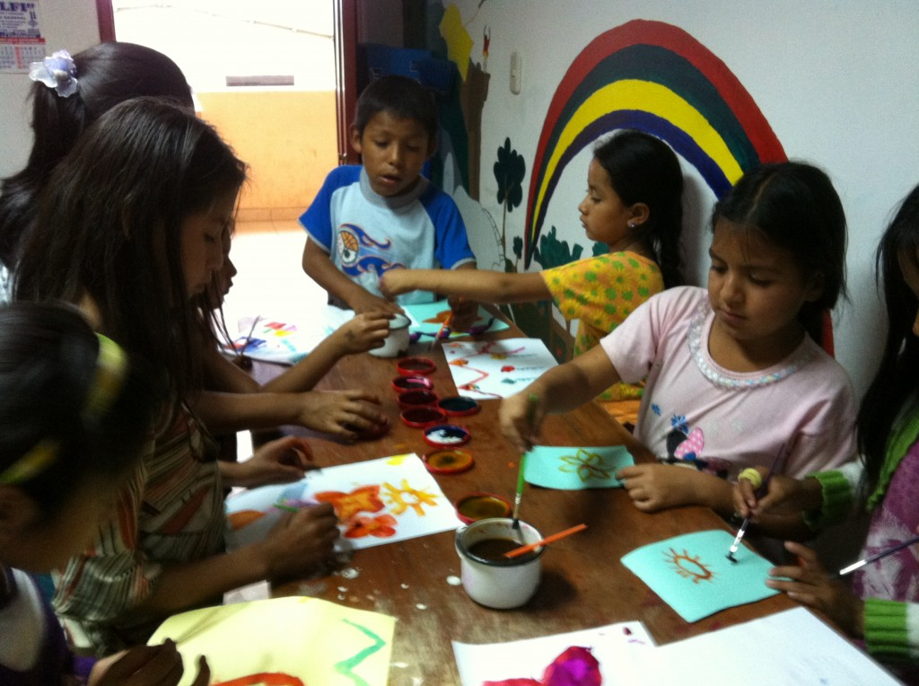 Children painting in the library in Huyro